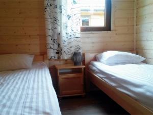 Sypialnia w Domkach pod Dębami